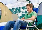 Camper using laptop