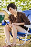 Camper text messaging on cell phone