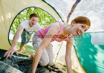 Couple climbing into tent