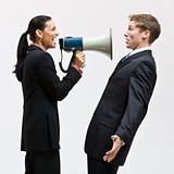 Businesswoman using megaphone