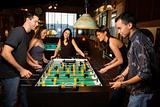 Group of People Playing Foosball