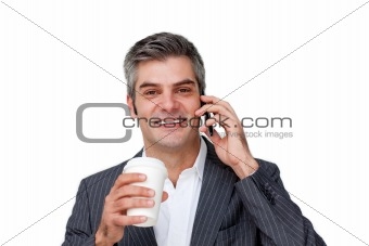Smiling Businessman on phone while drinking a coffee