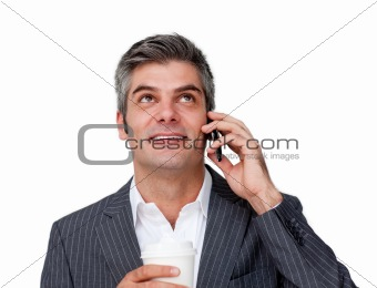 Attractive businessman on phone looking up