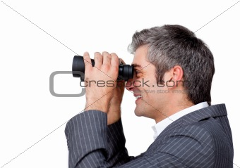 Smiling Attractive businessman looking through binoculars isolated on a white background