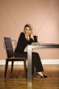 Attractive Young Businesswoman Sitting at a Table