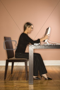 Attractive Young Businesswoman Looking at Computer Surprised