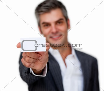 Positive businessman showing a white card