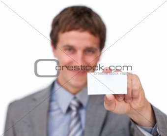 Blond businessman showing a white card