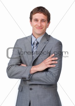Attractive businessman with folded arms smiling at the camera