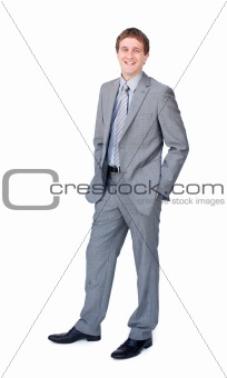 Positive businessman standing with hands in pockets