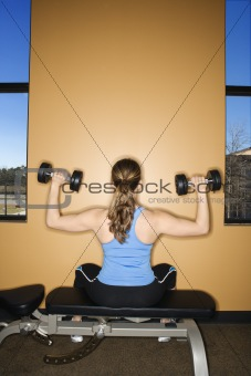 Woman Seated Lifting Weights