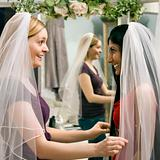 Friends trying on veils.