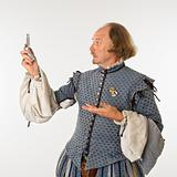 Shakespeare looking at phone.