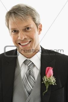 Groom in tuxedo.