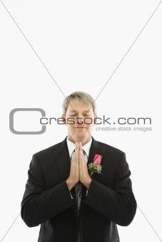 Groom praying.
