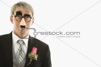 Groom wearing groucho glasses.