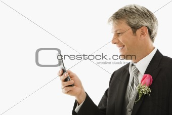 Groom using his cellphone.