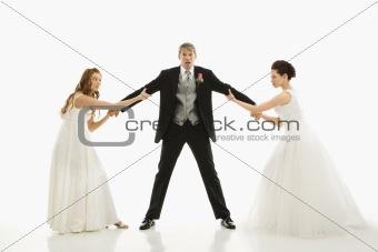Brides fighting over groom.