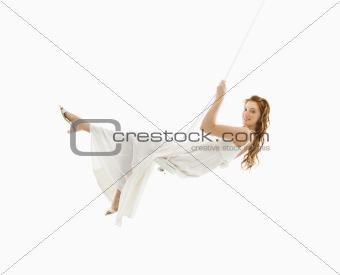 Bride in swing set.