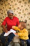 Grandmother with grandson coloring.