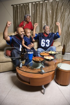 African-American family watching sports on tv.