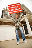Middle-aged man holding a for sale sign.