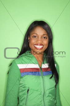 African-American woman in green coat.