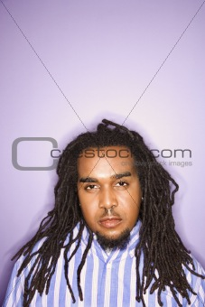 African-American man on purple background.