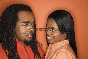 African-American couple wearing orange clothing.