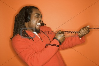 African-American man wearing headphones.