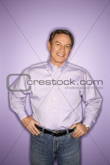 Caucasian man wearing purple clothing.