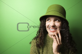 Caucasian woman wearing green clothing and hat.