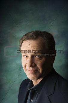 Caucasian man on studio background.