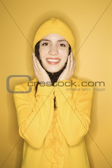 Caucasian woman wearing yellow raincoat.