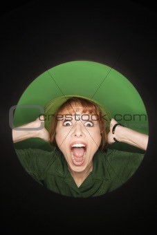 Caucasian woman with surprised expression wearing hat.