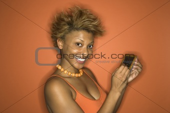 African-American woman portrait holding pda.