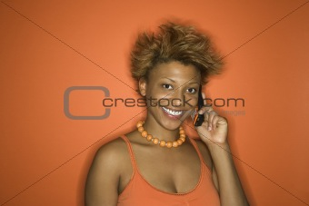 African-American woman portrait with cellphone.