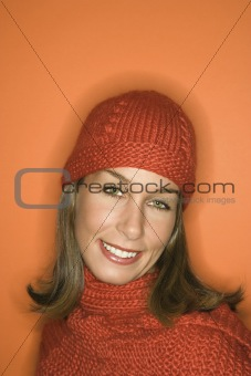 Caucasian woman wearing winter hat and scarf.