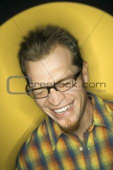 Caucasian man laughing.