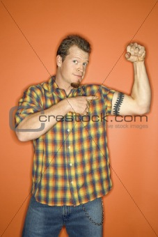 Caucasian man flexing his arm muscle.