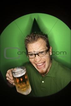 Caucasian man wearing holding beer.