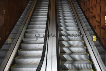 Ascending and descending escalators.