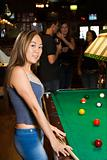 Young female at pool table.