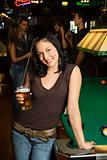 Young woman holding beer.