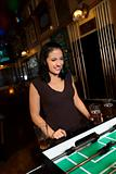 Young woman playing foosball.