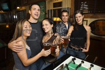 Group of young adults at bar.