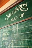 Sign-up chalkboard for billiards.