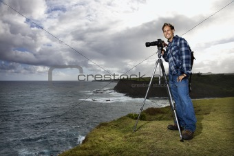 Man photographing scenery in Maui, Hawaii.