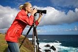 Woman photographing scenery in Maui, Hawaii.