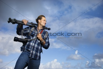 Man holding photography equipment.